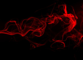 Movement of red smoke on black background. fire design