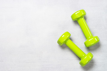 Dumbbells on white background top view.