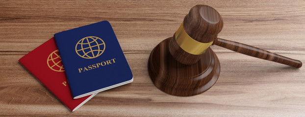 Two passports and a judge gavel on wooden desk background. 3d illustration