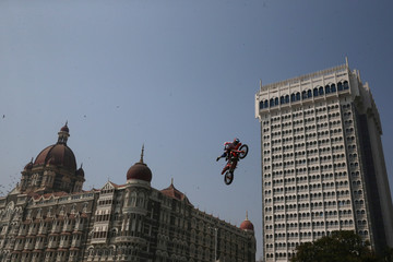 Radek Bilek of Czech Republic performs during the freestyle motocross games Red Bull FMX Jam in front of Taj Mahal hotel in Mumbai