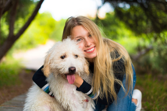 Young girl with her dog in a park