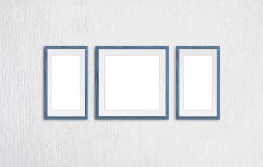 Blank photo frames mock up, three grey blue realistic wooden frameworks on white plastered wall, 3d illustration