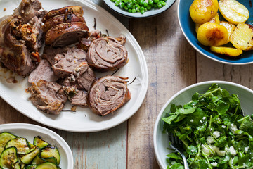 Easter meal with roast lamb, potatoes, courgette, garden peas and watercress salad