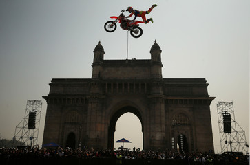 Alexey Kolesnikov of Russia performs during the freestyle motocross games Red Bull FMX Jam at the Gateway of India monument in Mumbai