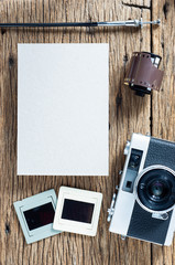 Antique photography concept with vintage camera film and blank paper for text or image
