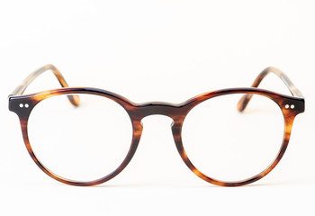 Brown styled glasses close-up isolated on white background  Wall mural