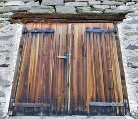 wooden old door on a stoned house