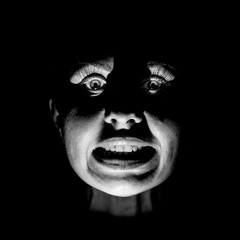 Portrait of a scared caucasian woman. Scary and fear concept. Black and white shot, low key lighting. Isolated on black.