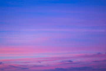 Fantastic colors in the nature, a beautiful pink, purple and blue sky with clouds just before sunrise. Natural cloudscape background.