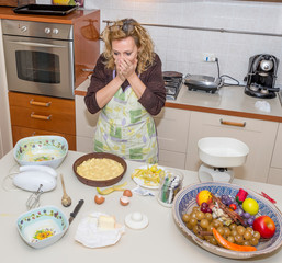 Desperate housewife can not believe the mess she made to prepare the meal