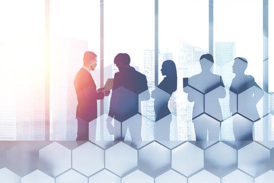 People in meeting room, hexagons