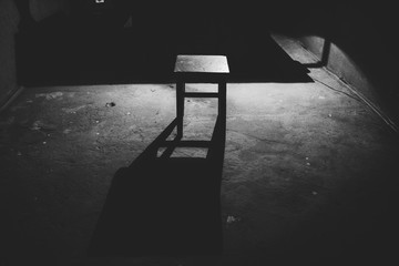 one stool in an empty dark and scary room