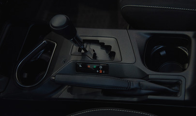 automatic transmission shift selector in the car interior
