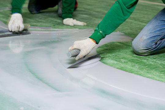 Construction series: Workers working on epoxy floor