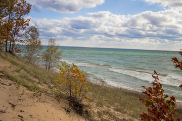 Lake Michigan Beach. View from the top of a Lake Michigan sand dune over the sunny blue waters of Lake Michigan.