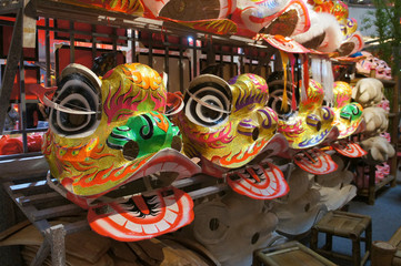Chinese tradition lion mask or lion head displayed on rack. It is used to performed lion dance during Chinese New Year Festival.