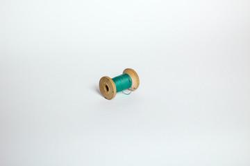 green virid vintage thread on white background
