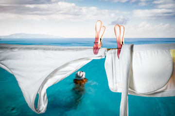 Bathing suit on a string by the pool in an exotic resort