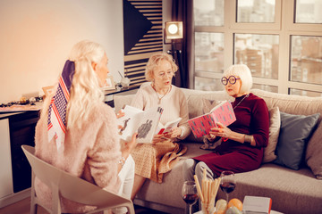 Nice smart aged women discussing different books