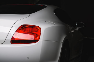 Car detailing series: Clean taillight of white luxury car