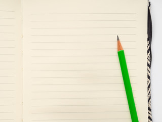 Blank page of lined notebook with pencil