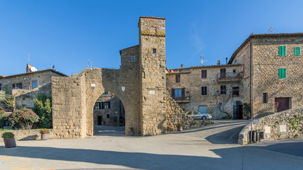 The ancient gateway to the medieval village of Monticchiello, Siena, Tuscany, Italy