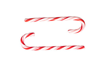 Traditional Christmas striped candy cane isolated on a white background. Top view.