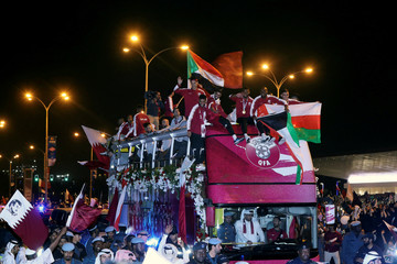 Qatar players celebrate after winning the Asian Cup in Doha
