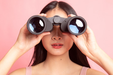 Young Asian woman with binoculars.