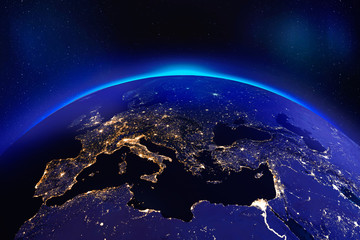 Europe at night from space with glowing city lights - Elements of this image furnished by NASA