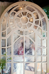 vintage mirror with white wooden frame