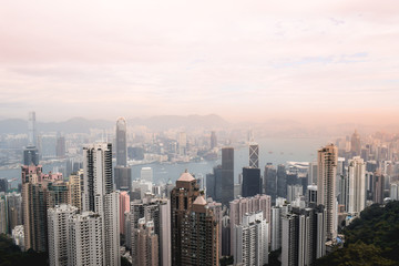 Beutiful pink sunset view on the Hong Kong skyline and the Victoria Harbour from the Peak