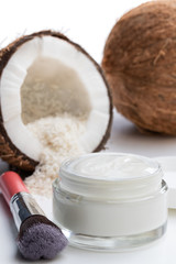 Homemade organic cosmetics with coconut on white background