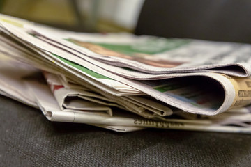 stack of newspapers paper edition texture base design morning press fresh gossip news sports achievement