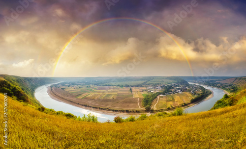 Wall mural Fantastic view of the sinuous river flowing through mountains. Location place Dnister canyon, Ukraine, Europe.