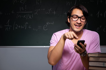 Young male student sitting in classroom