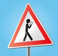 Schild Achtung mit Piktogramm Ablenkung durch Smartphone