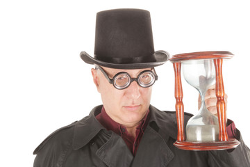 Time Master is measuring time with hourglass is running out