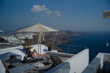 A woman sunbathes on a deck