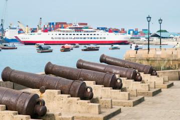 old guns on embankment in front of harbor in Zanzibar in Tanzania