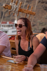 Friends enjoy each other's company on a boat cruise