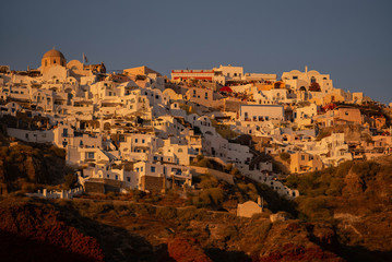 Old Port in the village Oia on Santorini island in the Aegean Sea. Greece. at Sunset
