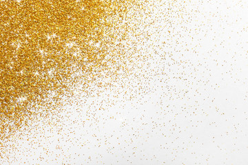 Bright beautiful shining golden glitter on white background, top view