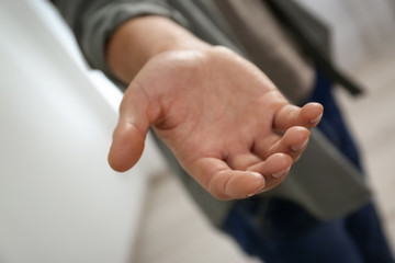 Man giving hand to somebody, closeup. Help and support concept