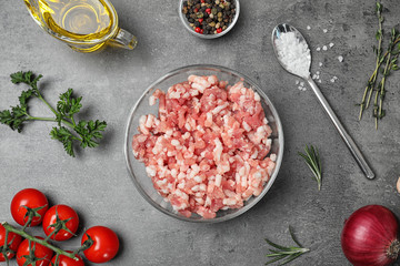 Flat lay composition with minced meat on grey background
