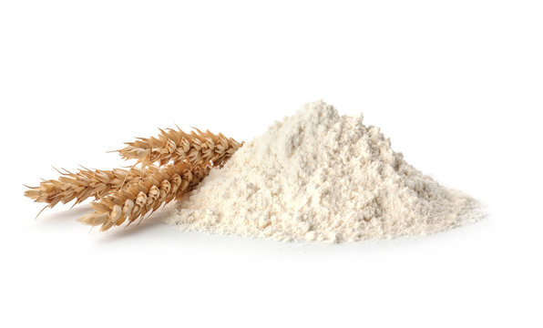Fresh flour and ears of wheat isolated on white