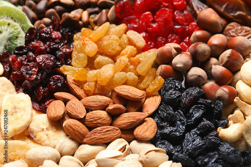 Different dried fruits and nuts as background, closeup