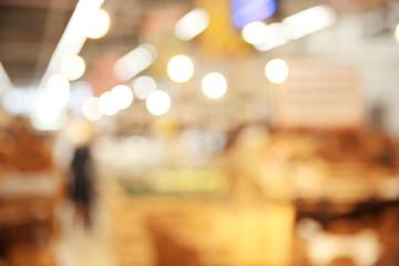 Blurred view of modern supermarket interior
