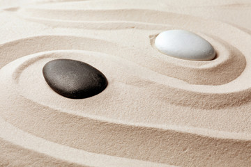 Poster Stones in Sand Zen garden stones on sand with pattern. Meditation and harmony