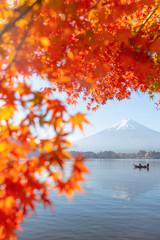 Red maple leaves and Mt. fuji in autumn season at Kawaguchiko lake